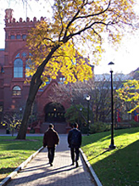 two people walking on campus